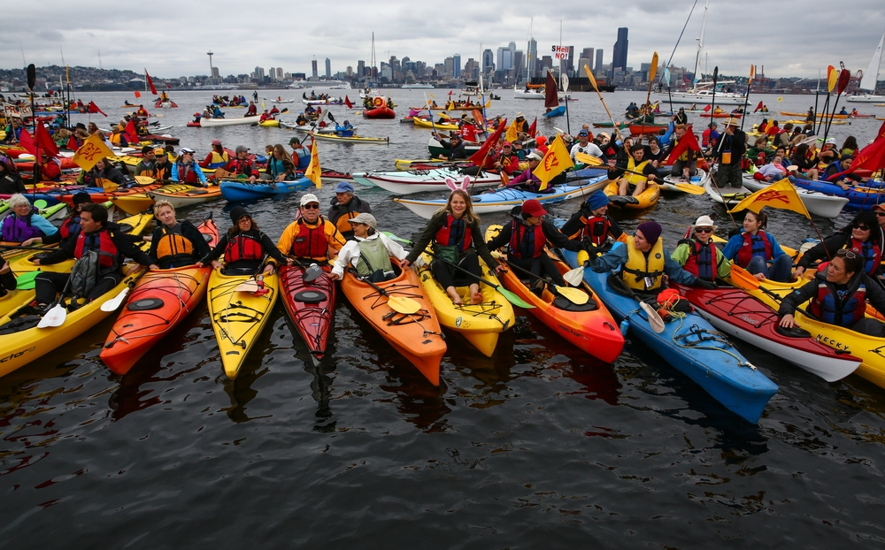 Hundreds of kayaktivists take to the water during protest against drilling in the Arctic and the Port of Seattle being used as a port for the Shell Oil drilling rig Polar Pioneer. Photographed on Saturday, May 16, 2015.