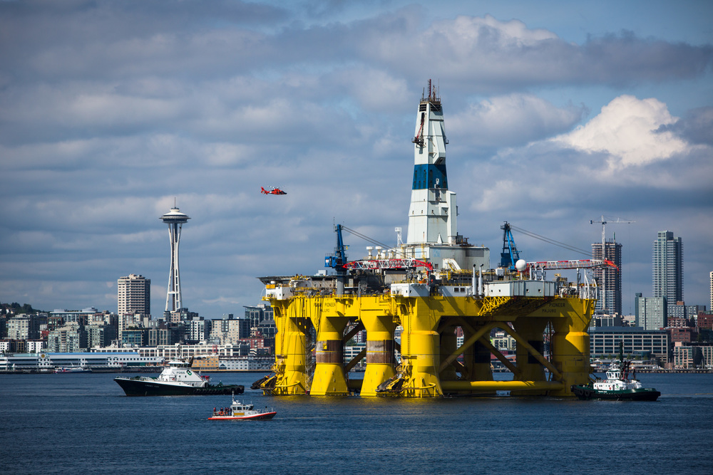 The Polar Pioneer arrives in Seattle minutes before kayaktivists took to the water to protest the potentially dangerous environmental impacts of arctic drilling. The protest flotilla drew many paddlers to show their displeasure with the rig being moored in Seattle. Photographed on Saturday, May 16, 2015.
