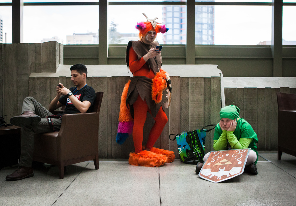 Participants pause for a break during day two of Emerald City Comicon at the Washington State Convention Center on Saturday, March 28, 2015. The three day convention is the largest comic book and pop culture convention in the Pacific Northwest. The convention features cosplay, comic books, celebrities and more.