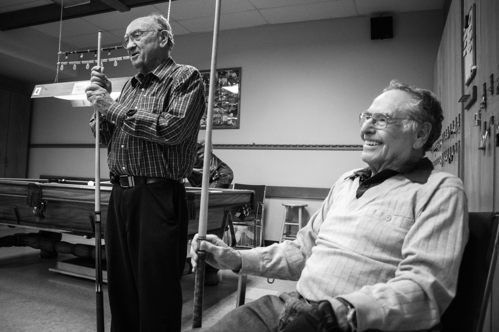 Bob Souders and Ira Weber laugh together during a pool game at the Senior Activity Center in Bellingham. Pool is one of the many ways seniors can spend time with other seniors at the center.