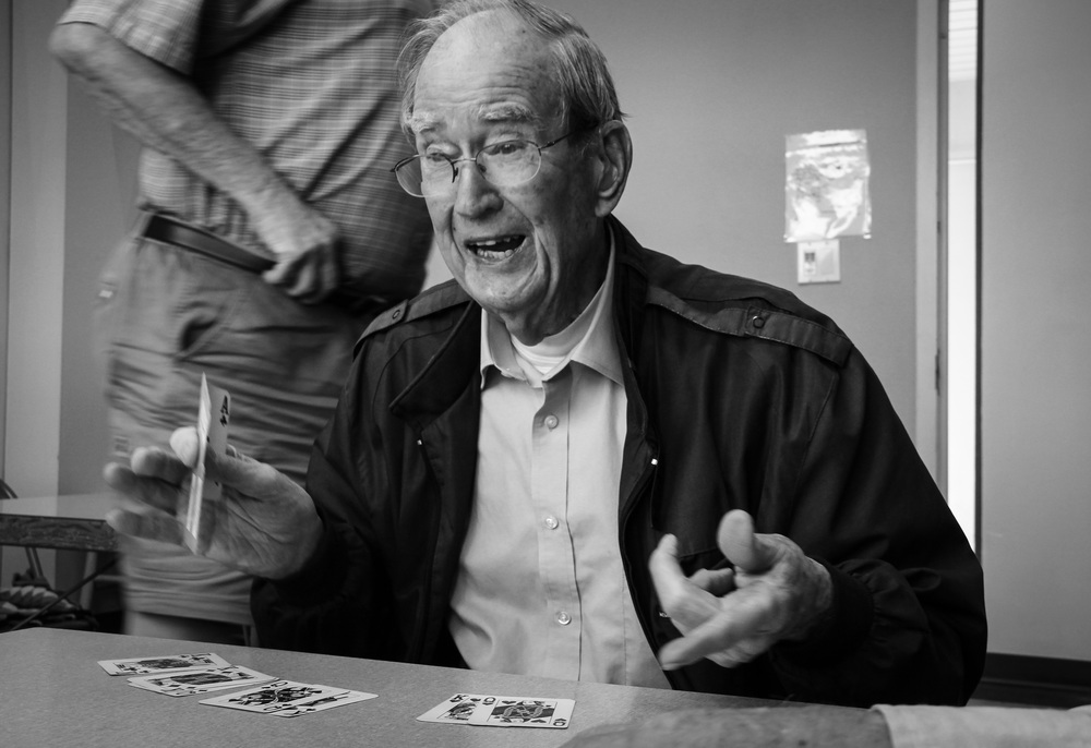 "Ralph Carmichael, 90, laughs during a game of Pinochle at the senior center. He taught a class about computers at the center for 12 years and now enjoys playing cards with his friends. ""This game keeps our minds going,"" Carmichael said. Keeping an active mind and lifestyle is a theme throughout the center, but mostly they come to just enjoy the the last years of their life with each other."