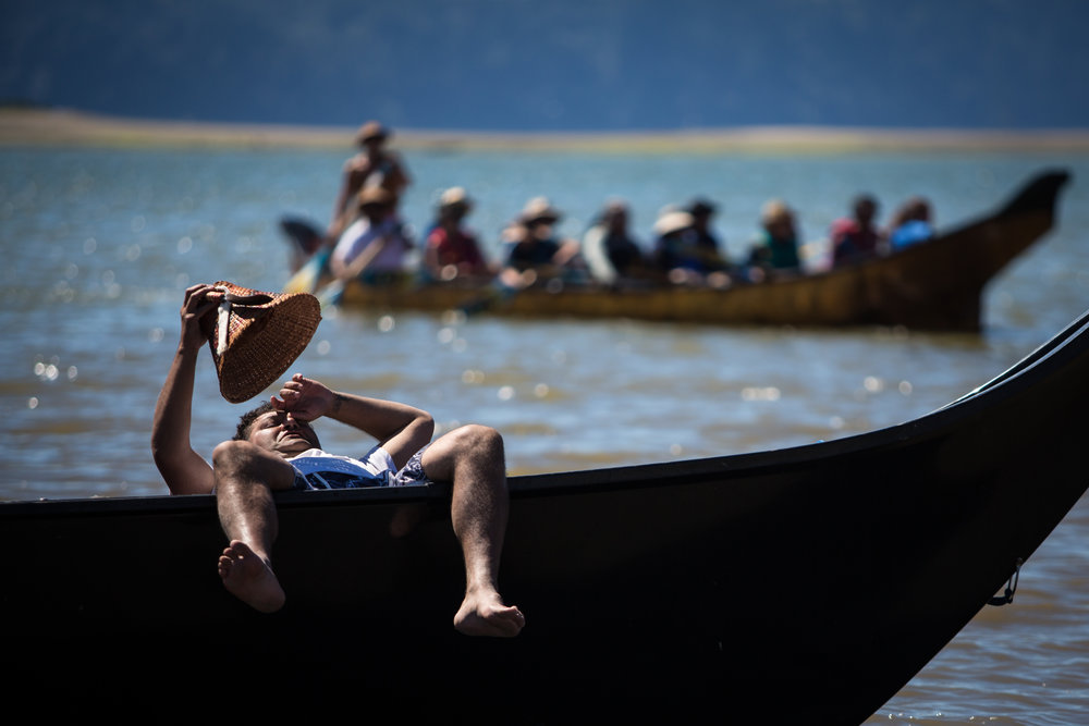 A paddler rests in the hot sun in Tulalip Bay during the annual Tribal Canoe Journey on Sunday July 24. Hundreds gathered to welcome tribes from the Pacific Northwest on their journey to the gathering place in Nisqually.