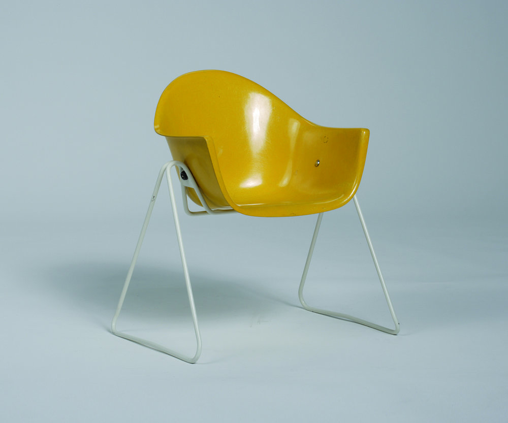 Walter Papst and Dieter Thern designed the convertible child's chair (1961–1968) for the German firm Wilkhahn. The glass-reinforced polyester (fiberglass) shell seat with a tubular steel base can be reconfigured into a rocker, high chair, or swing. © Wilkhahn