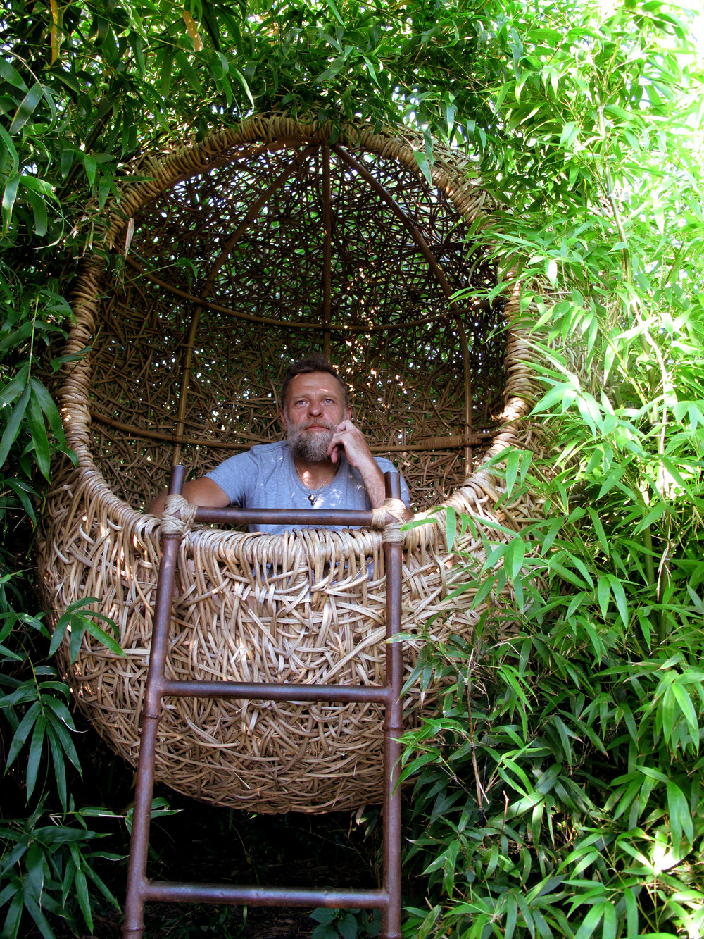 Porky Hefer sits in one of his weaver's nests. Photo courtesy of Southern Guild.