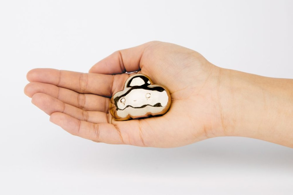 Little Cloud  pocket amulet. Photo by Addam Rodriguez and Sydney Chen.