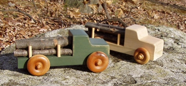 Logging trucks finished with milk paint by Lomft Toys. Photo via  lomft.com .