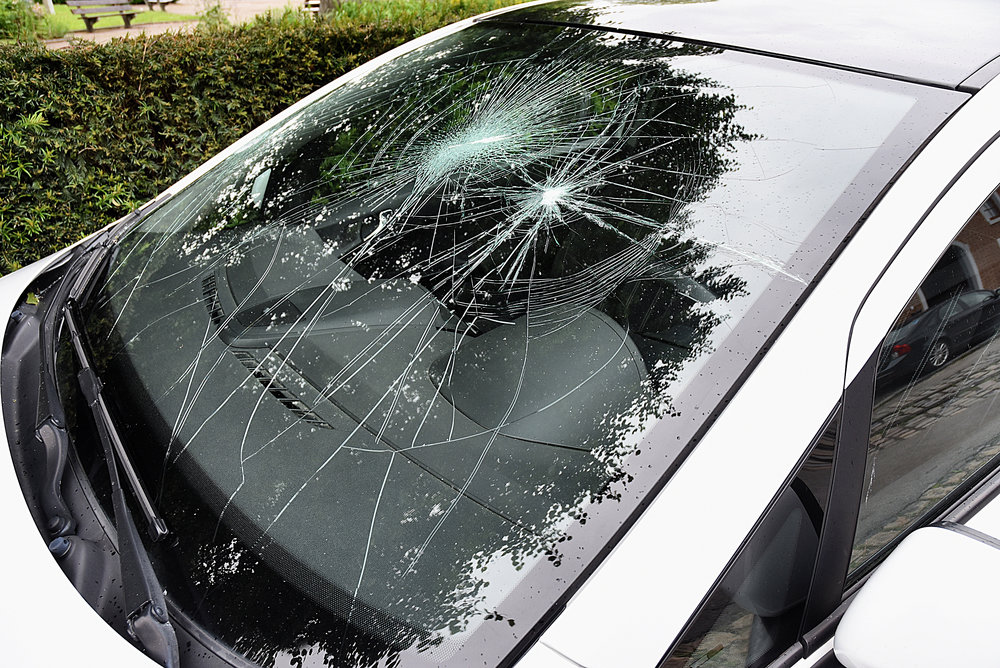 bigstock-Broken-Car-Windshield-135091478.jpg