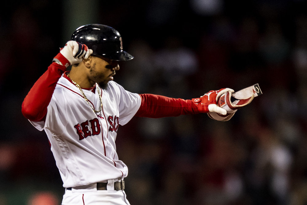 September 9, 2018 - Boston, MA: Boston Red Sox outfielder Mookie Betts shakes his hips after hitting a double  as the Boston Red Sox face the Houston Astros at Fenway Park in Boston, Massachusetts on Sunday, September 9, 2018. (Photo by Matthew Thomas/Boston Red Sox)