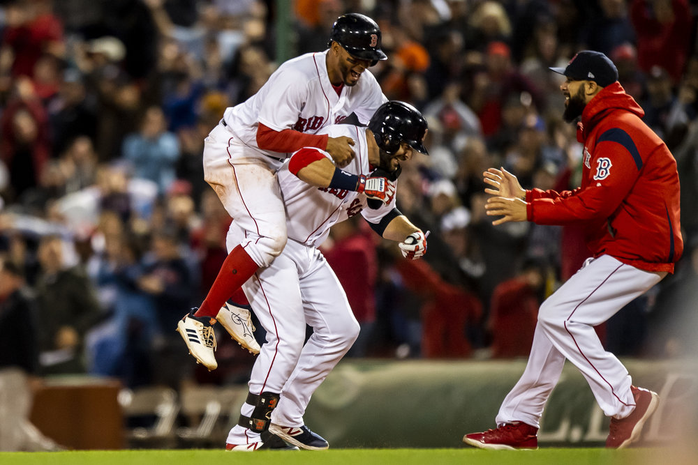 September 9, 2018 - Boston, MA: Boston Red Sox shortstop Xander Bogaerts jumps of Boston Red Sox first basemen Mitch Moreland's back after Moreland hit the winning walk-off single after the Boston Red Sox defeated the Houston Astros at Fenway Park in Boston, Massachusetts on Sunday, September 9, 2018. (Photo by Matthew Thomas/Boston Red Sox)