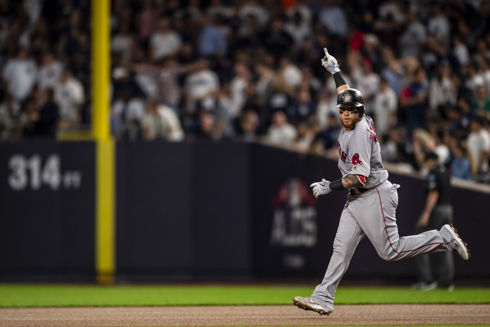 October 9, 2018, New York, NY: Boston Red Sox catcher Christian Vazquez points as he rounds the base after hitting a home run as the Boston Red Sox face the New York Yankees in Game 4 of the ALDS at Yankee Stadium in New York, New York on Tuesday, October 9, 2018. (Photo by Matthew Thomas/Boston Red Sox)