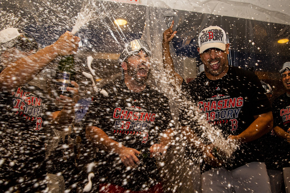 October 9, 2018, New York, NY: Boston Red Sox Manager Alex Cora empties a bottle of champagne after the Boston Red Sox defeated the New York Yankees in Game 4 of the ALDS to win the series at Yankee Stadium in New York, New York on Tuesday, October 9, 2018. (Photo by Matthew Thomas/Boston Red Sox)