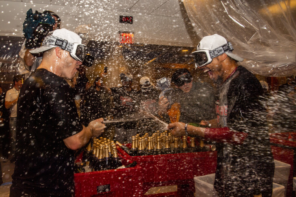 October 9, 2018, New York, NY: Boston Red Sox infielder Brock Holt and Boston Red Sox outfielder Mookie Betts sprays champagne on each other after the Boston Red Sox defeated the New York Yankees in Game 4 of the ALDS to win the series at Yankee Stadium in New York, New York on Tuesday, October 9, 2018. (Photo by Matthew Thomas/Boston Red Sox)