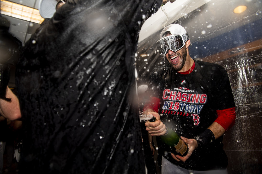 October 9, 2018, New York, NY: Boston Red Sox outfielder J.D. Martinez sprays champagne after the Boston Red Sox defeated the New York Yankees in Game 4 of the ALDS to win the series at Yankee Stadium in New York, New York on Tuesday, October 9, 2018. (Photo by Matthew Thomas/Boston Red Sox)