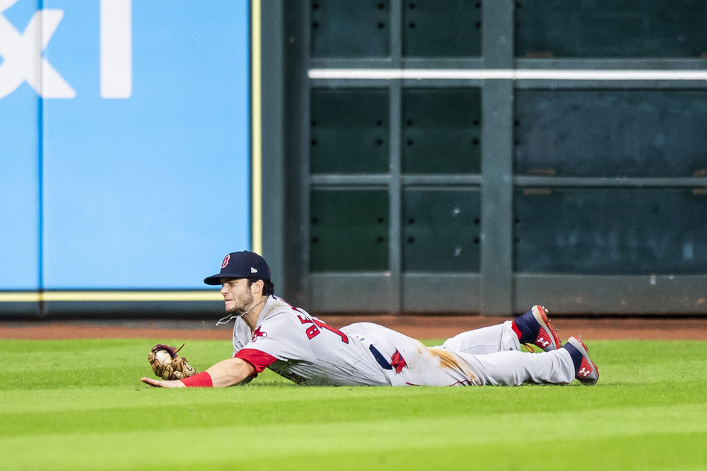 October 17, 2018, Houston, TX: Boston Red Sox outfielder Andrew Benintendi makes the game winning catch after the Boston Red Sox defeated the Houston Astros in Game 4 of the ALCS at Minute Maid Park in Houston, Texas on Wednesday, October 17, 2018. (Photo by Matthew Thomas/Boston Red Sox)