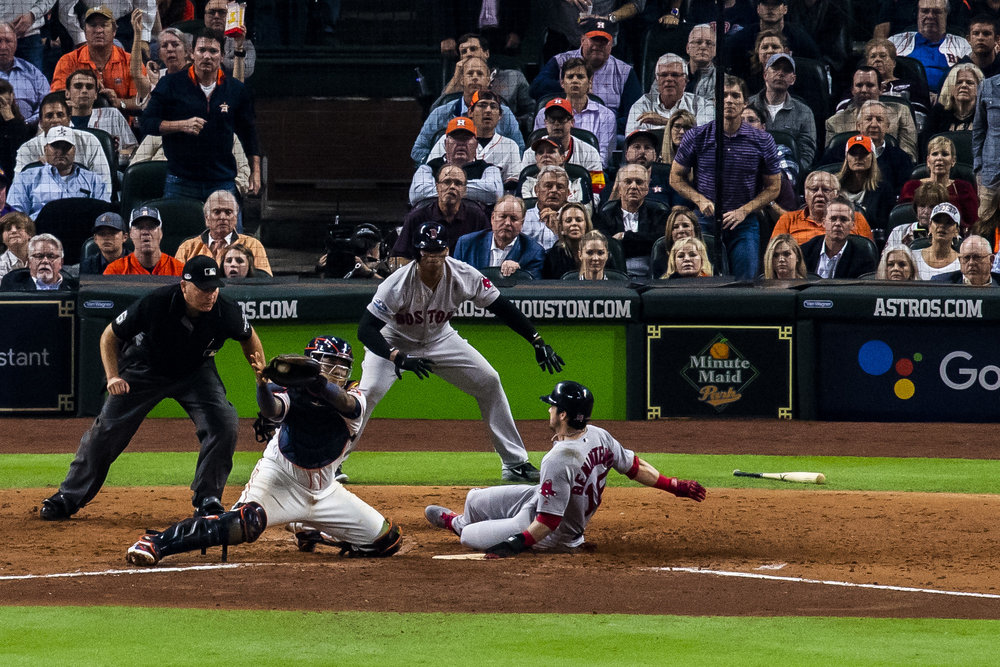 October 17, 2018, Houston, TX: Boston Red Sox outfielder Andrew Benintendi slides safely into home plate as the Boston Red Sox face the Houston Astros in Game 4 of the ALCS at Minute Maid Park in Houston, Texas on Wednesday, October 17, 2018. (Photo by Matthew Thomas/Boston Red Sox)