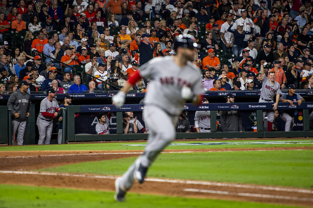 October 17, 2018, Houston, TX: Boston Red Sox infielder Brock Holt and the bench cheer as Boston Red Sox outfielder J.D. Martinez gets a hit as the Boston Red Sox face the Houston Astros in Game 4 of the ALCS at Minute Maid Park in Houston, Texas on Wednesday, October 17, 2018. (Photo by Matthew Thomas/Boston Red Sox)