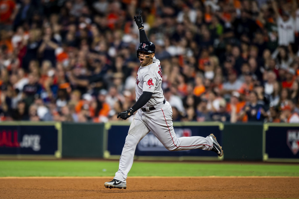 October 18, 2018, Houston, TX: Boston Red Sox third basemen Rafael Devers celebrates hitting a home run as he rounds the bases as the Boston Red Sox face the Houston Astros in Game 5 of the ALCS at Minute Maid Park in Houston, Texas on Thursday, October 18, 2018. (Photo by Matthew Thomas/Boston Red Sox)