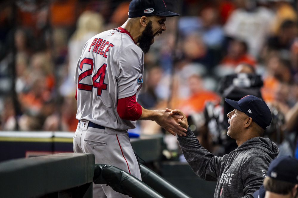 October 18, 2018, Houston, TX: Boston Red Sox pitcher David Price celebrates with Boston Red Sox Manager Alex Cora after striking out the final batter of the inning as the Boston Red Sox face the Houston Astros in Game 5 of the ALCS at Minute Maid Park in Houston, Texas on Thursday, October 18, 2018. (Photo by Matthew Thomas/Boston Red Sox)