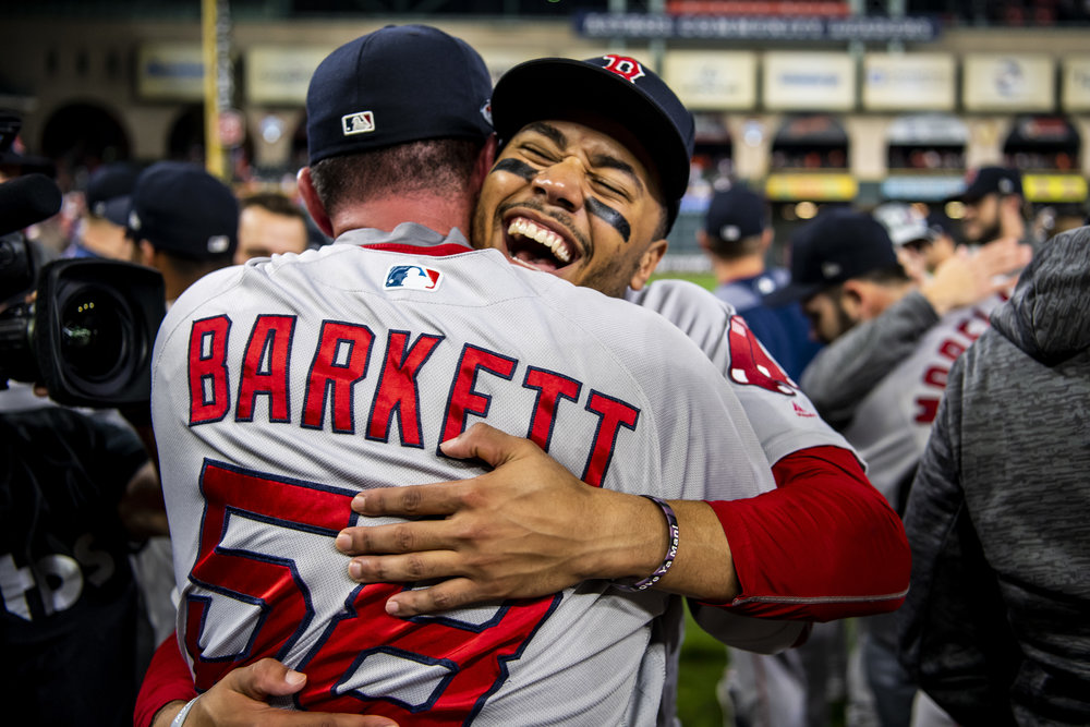 October 18, 2018, Houston, TX: Boston Red Sox outfielder Mookie Betts hugs Boston Red Sox Assistant Hitting Coach Andy Barkett after the Boston Red Sox defeated the Houston Astros in Game 5 of the ALCS to advance to the World Series at Minute Maid Park in Houston, Texas on Thursday, October 18, 2018. (Photo by Matthew Thomas/Boston Red Sox)