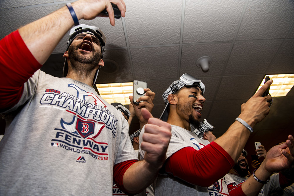 October 18, 2018, Houston, TX: Boston Red Sox outfielder J.D. Martinez and Boston Red Sox outfielder Mookie Betts take photos with their phones of the trophy presentation after the Boston Red Sox defeated the Houston Astros in Game 5 of the ALCS to advance to the World Series at Minute Maid Park in Houston, Texas on Thursday, October 18, 2018. (Photo by Matthew Thomas/Boston Red Sox)