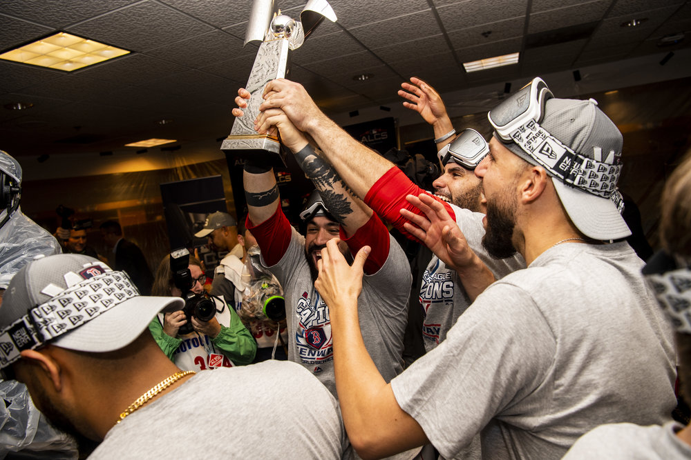 October 18, 2018, Houston, TX: Boston Red Sox catcher Sandy Leon holds onto the ALCS Championship trophy after the Boston Red Sox defeated the Houston Astros in Game 5 of the ALCS to advance to the World Series at Minute Maid Park in Houston, Texas on Thursday, October 18, 2018. (Photo by Matthew Thomas/Boston Red Sox)