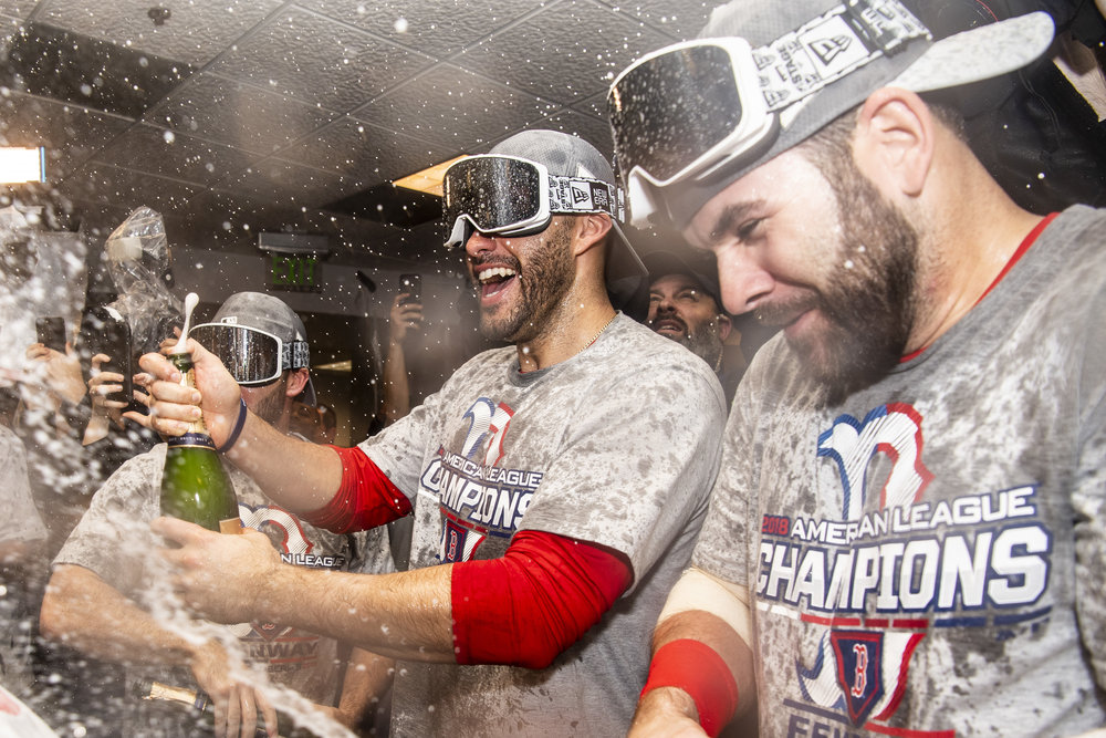 October 18, 2018, Houston, TX: Boston Red Sox outfielder J.D. Martinez and Boston Red Sox first basemen Mitch Moreland sprays champagne after the Boston Red Sox defeated the Houston Astros in Game 5 of the ALCS to advance to the World Series at Minute Maid Park in Houston, Texas on Thursday, October 18, 2018. (Photo by Matthew Thomas/Boston Red Sox)