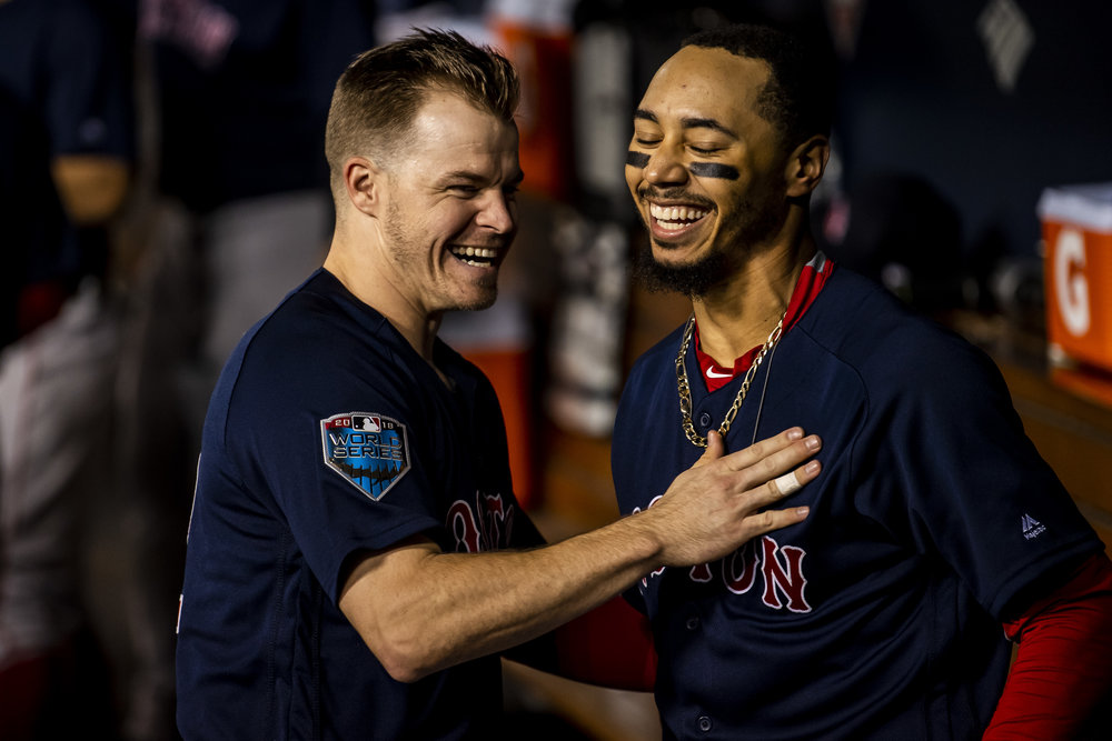 October 28, 2018, Los Angeles, Ca: Boston Red Sox outfielder Mookie Betts laughs with Boston Red Sox infielder Brock Holt after hitting a home run as the Boston Red Sox face the Los Angeles Dodgers in Game 5 of the World Series at Dodger Stadium in Los Angeles, California on Saturday, October 28, 2018. (Photo by Matthew Thomas/Boston Red Sox)