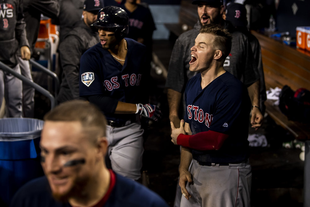 October 28, 2018, Los Angeles, Ca: Boston Red Sox infielder Brock Holt reacts to Boston Red Sox infielder Steve Pearce's home run as the Boston Red Sox face the Los Angeles Dodgers in Game 5 of the World Series at Dodger Stadium in Los Angeles, California on Saturday, October 28, 2018. (Photo by Matthew Thomas/Boston Red Sox)