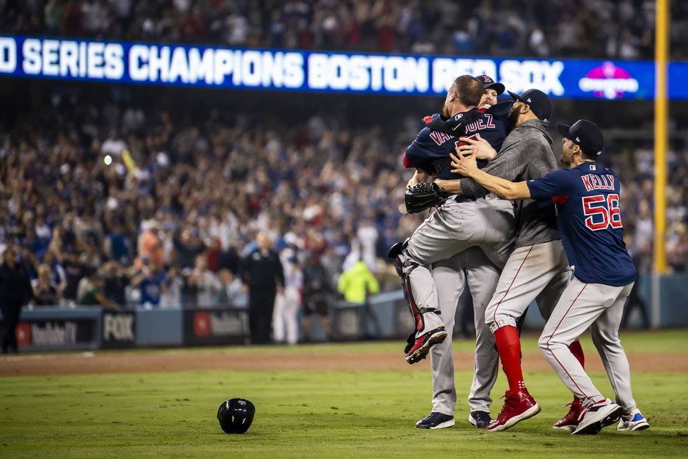 October 28, 2018, Los Angeles, Ca: Boston Red Sox catcher Christian Vazquez leaps into Boston Red Sox pitcher Chris Sale's arms after the Boston Red Sox defeated the Los Angeles Dodgers in Game 5 to win the World Series at Dodger Stadium in Los Angeles, California on Saturday, October 28, 2018. (Photo by Matthew Thomas/Boston Red Sox)