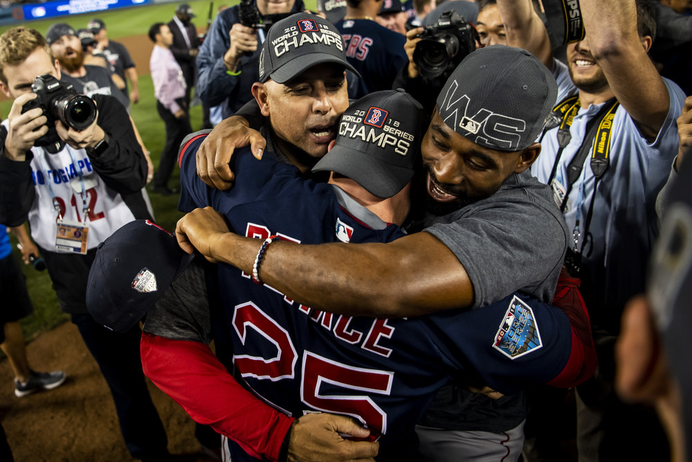 October 28, 2018, Los Angeles, Ca: Boston Red Sox Manager Alex Cora, Boston Red Sox infielder Steve Pearce and Boston Red Sox outfielder Jackie Bradley Jr. hug after the Boston Red Sox defeated the Los Angeles Dodgers in Game 5 to win the World Series at Dodger Stadium in Los Angeles, California on Saturday, October 28, 2018. (Photo by Matthew Thomas/Boston Red Sox)