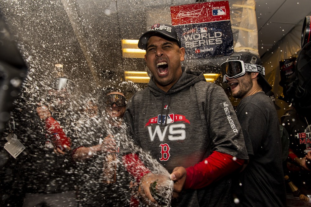 October 28, 2018, Los Angeles, Ca: Boston Red Sox Manager Alex Cora pops the first bottle of champagne after the Boston Red Sox defeated the Los Angeles Dodgers in Game 5 to win the World Series at Dodger Stadium in Los Angeles, California on Saturday, October 28, 2018. (Photo by Matthew Thomas/Boston Red Sox)