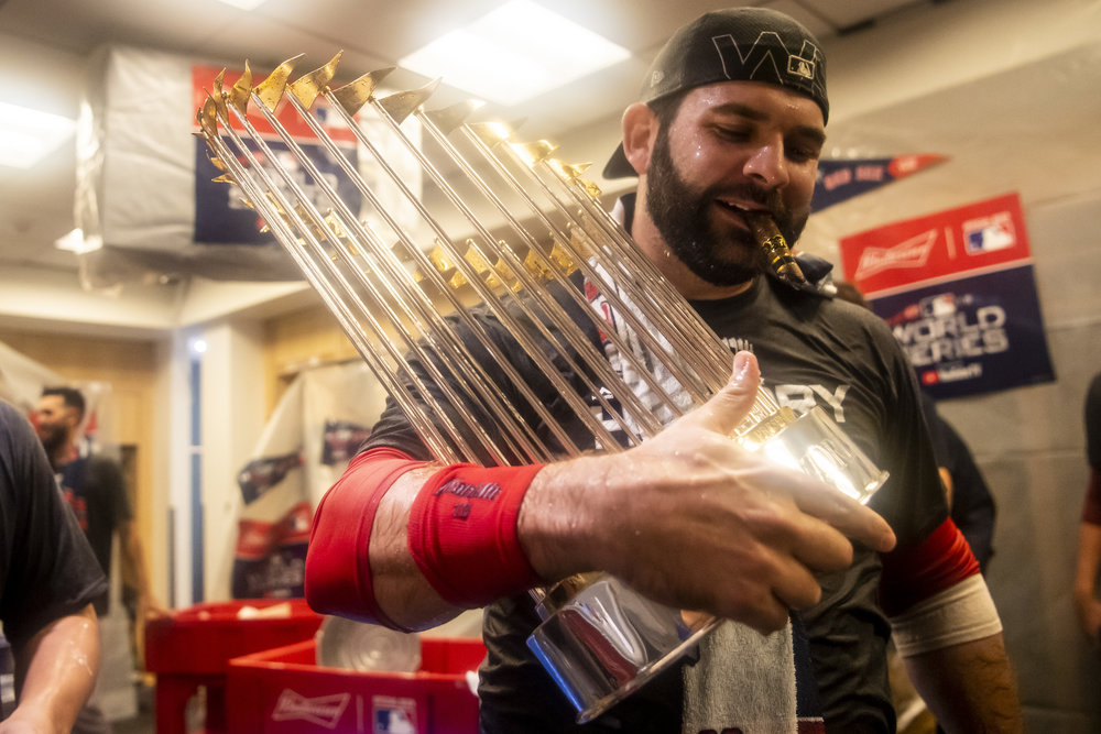 October 28, 2018, Los Angeles, Ca: Boston Red Sox first basemen Mitch Moreland holds up the World Series trophy  after the Boston Red Sox defeated the Los Angeles Dodgers in Game 5 to win the World Series at Dodger Stadium in Los Angeles, California on Saturday, October 28, 2018. (Photo by Matthew Thomas/Boston Red Sox)