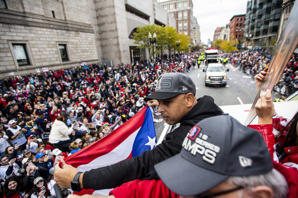 October 31, 2018, Boston, MA: Boston Red Sox Manager Alex Cora holds up the Puerto Rican flag as the Red Sox Celebrate the World Series Parade in Boston, Massachusetts on Wednesday, October 31, 2018. (Photo by Matthew Thomas/Boston Red Sox)