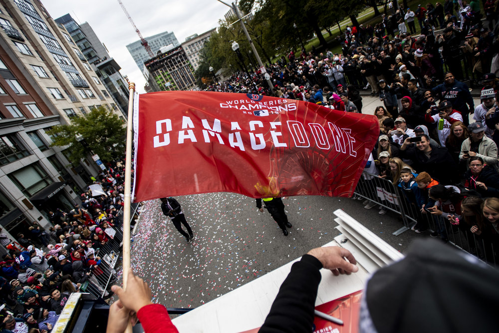 October 31, 2018, Boston, MA: Boston Red Sox Pitching Coach Dana LeVangie waves the 'Damage Done' flag as the Red Sox Celebrate the World Series Parade in Boston, Massachusetts on Wednesday, October 31, 2018. (Photo by Matthew Thomas/Boston Red Sox)