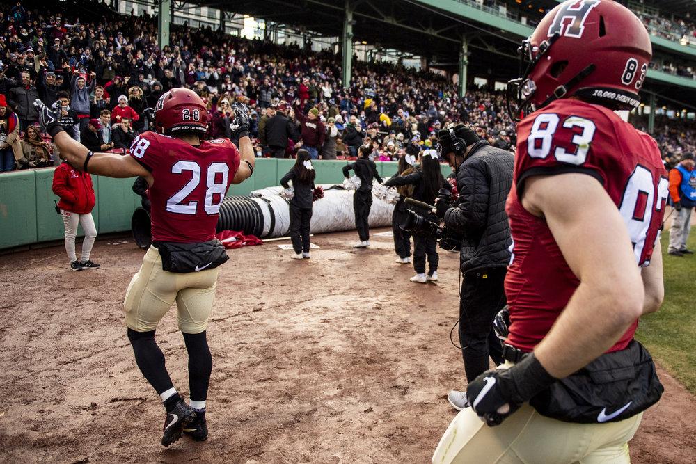November 16, 2018, Boston, MA: A Harvard football celebrates a touchdown during the Harvard University and Yale University football Game at Fenway Park in Boston, Massachusetts on Thursday, November 16, 2018. (Photo by Matthew Thomas/Boston Red Sox)