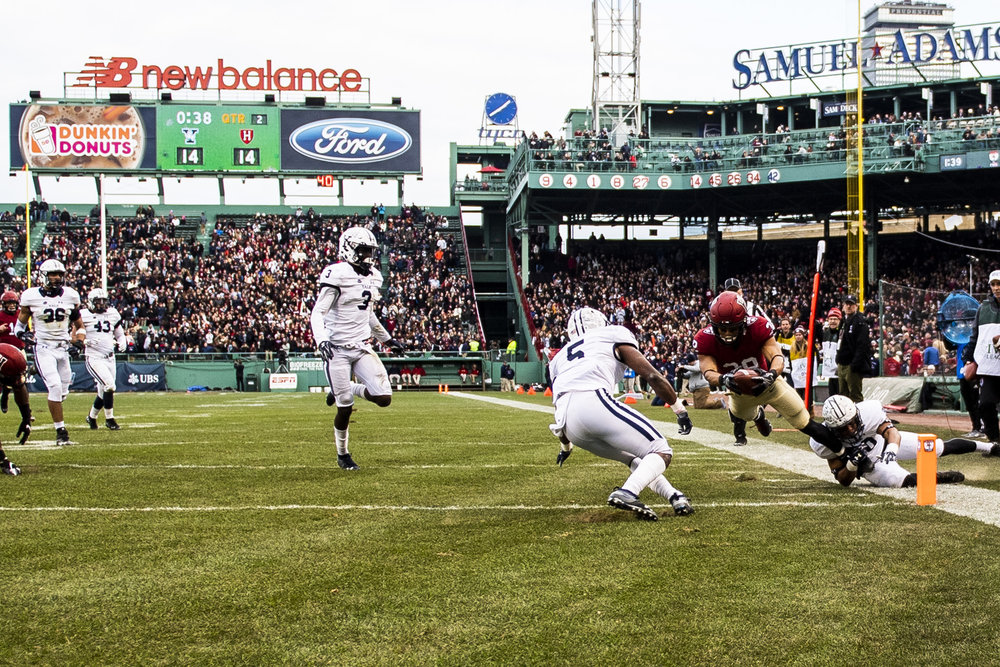 November 16, 2018, Boston, MA: A Harvard player dives for the end zone during the Harvard University and Yale University football Game at Fenway Park in Boston, Massachusetts on Thursday, November 16, 2018. (Photo by Matthew Thomas/Boston Red Sox)