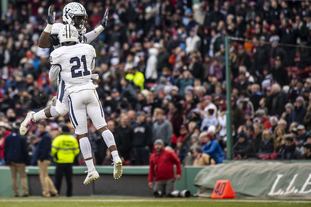 November 16, 2018, Boston, MA: A Yale football celebrates after breaking up a pass  during the Harvard University and Yale University football Game at Fenway Park in Boston, Massachusetts on Thursday, November 16, 2018. (Photo by Matthew Thomas/Boston Red Sox)