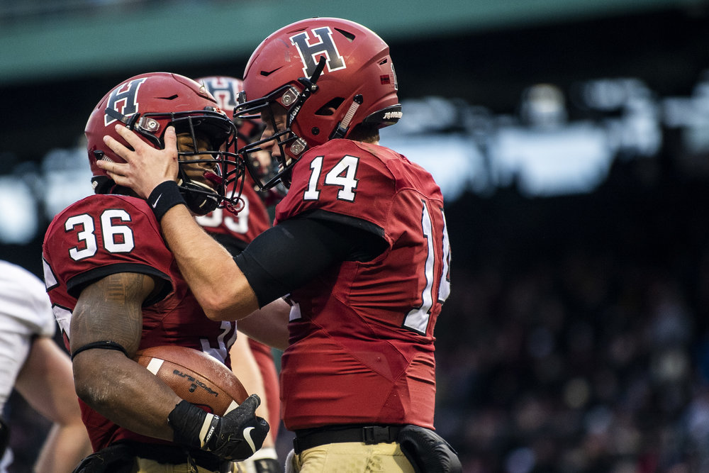 November 16, 2018, Boston, MA: A Harvard football celebrates after scoring a touchdown during the Harvard University and Yale University football Game at Fenway Park in Boston, Massachusetts on Thursday, November 16, 2018. (Photo by Matthew Thomas/Boston Red Sox)