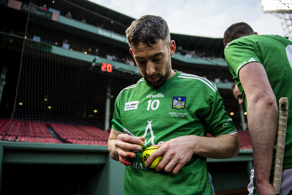 November 18, 2018, Boston, MA: A Limerick player signs autographs after a match during the Fenway Hurling Classic at Fenway Park in Boston, Massachusetts on Sunday, November 18, 2018. (Photo by Matthew Thomas/Boston Red Sox)