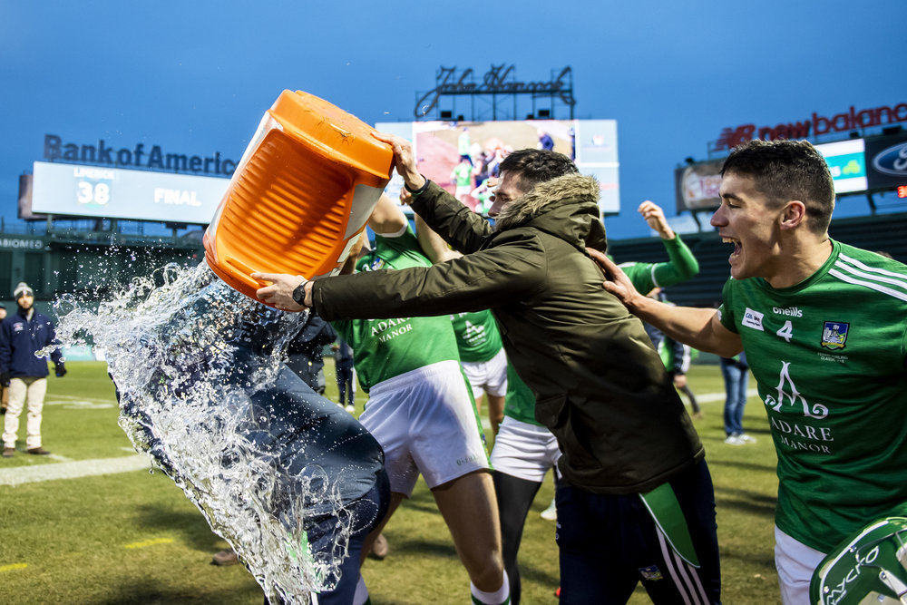 November 18, 2018, Boston, MA: Limerick players celebrate after defeating Cork in the Championship match during the Fenway Hurling Classic at Fenway Park in Boston, Massachusetts on Sunday, November 18, 2018. (Photo by Matthew Thomas/Boston Red Sox)