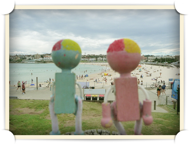 Mr. and Mrs. Lumberson survey the beach as volunteers for the North Bondi Surf Life Saving Club.
