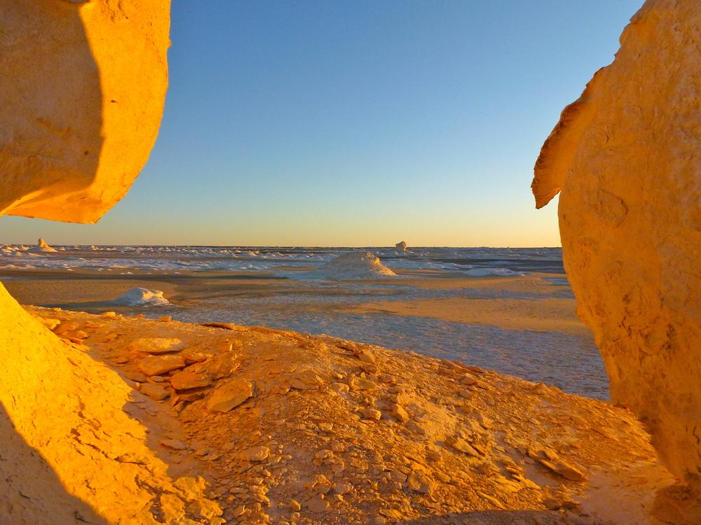 Sunset overthe salt pillars of the White Desert, Egypt.