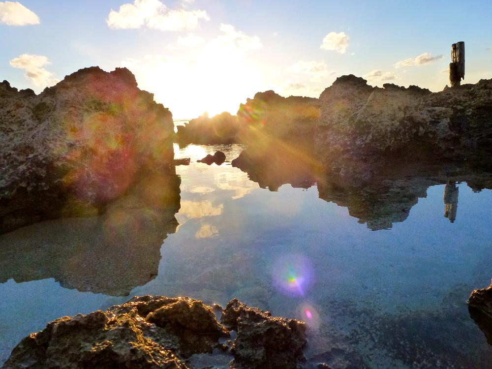 Rock pools at sunset tide in Eua, Tonga.