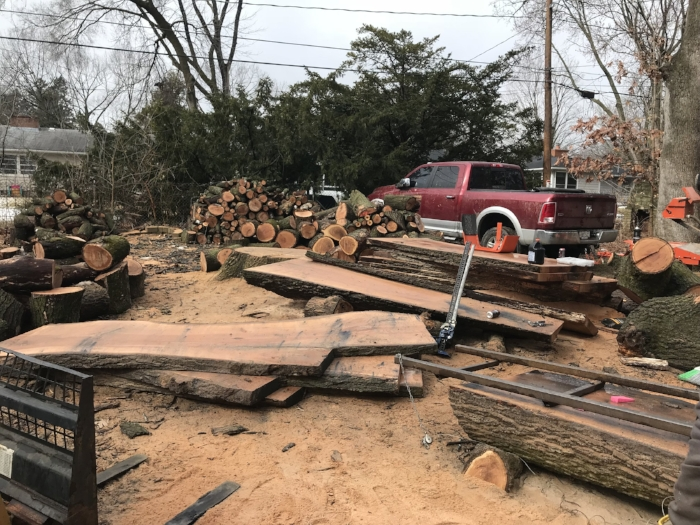 Milling red oak slabs salvaged from a fallen oak tree.