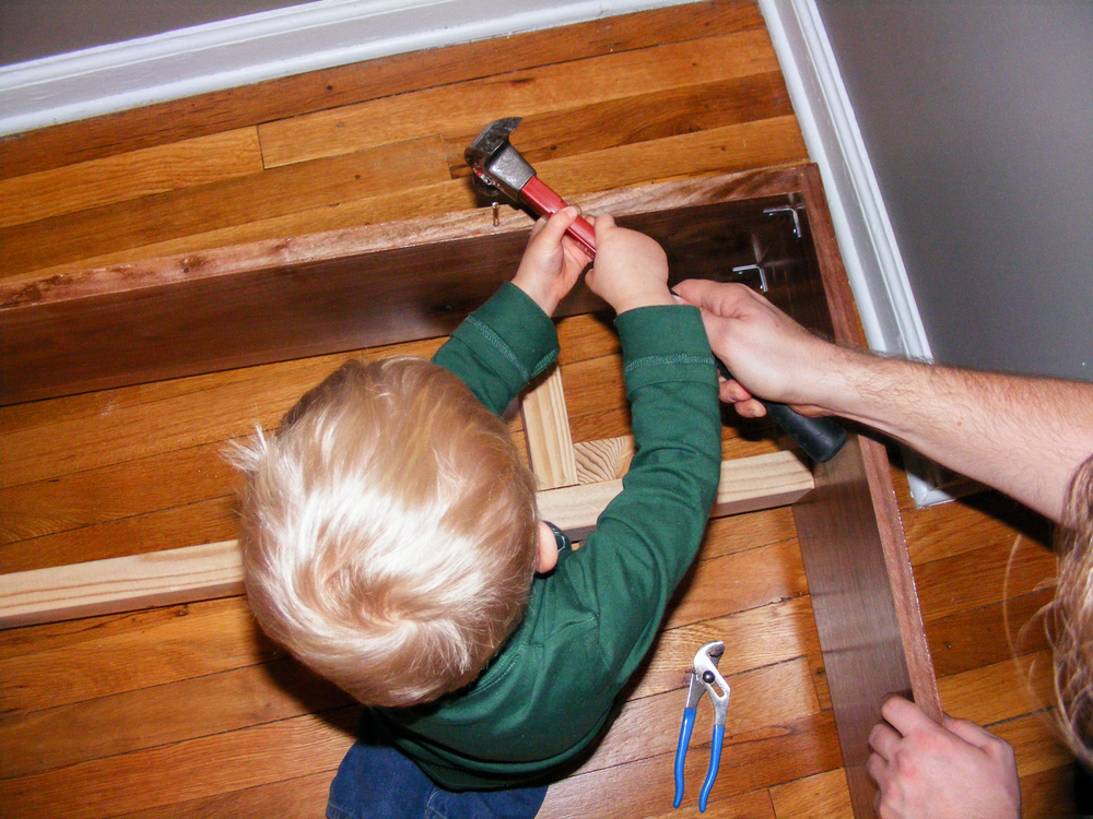 "Elias helped me tap 3"" brass pegs into each of the holes in the head rail using a hammer. Good job, Elias!"