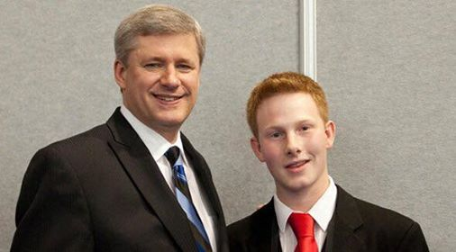 Adam (right) photographed with then Prime Minister Stephen Harper (left) during one of his Junior Team Canada Missions with Global Vision.