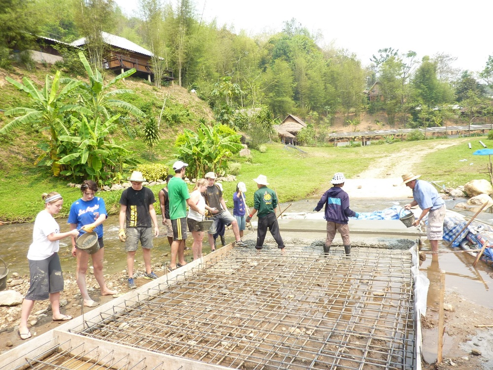 Compacting with bamboo poles