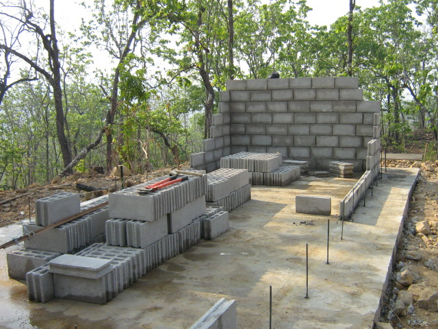 Laying the inner wall of concrete blocks to be used as formwork for the sediment tank