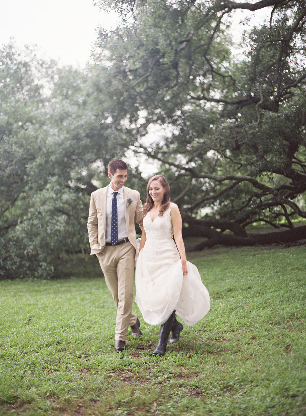 Sapphire Events | Catherine Guidry Photography | Wedding Planning | New Orleans Wedding | Stella Plantation Wedding | Blue and White Wedding | Classic Rainy Day Wedding | Outdoor Wedding | Tent Wedding | Hunter Boots | Blue and White Wedding Details | What to do when it rains on your wedding day