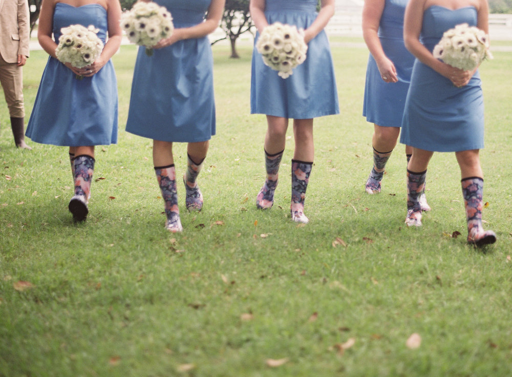 Sapphire Events | Catherine Guidry Photography | Wedding Planning | New Orleans Wedding | Stella Plantation Wedding | Blue and White Wedding | Classic Rainy Day Wedding | Outdoor Wedding | Tent Wedding | Hunter Boots | Blue and White Wedding Details |Blue bridesmaid dresses | Floral rain boots